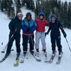 4 skiers group photo