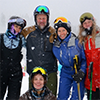 Skiing while snowing group photo